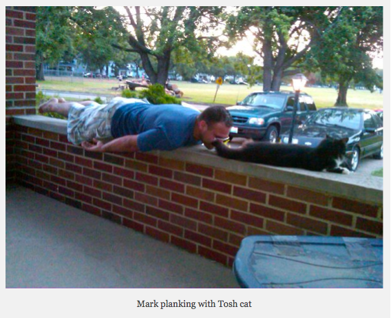 man planks with cat