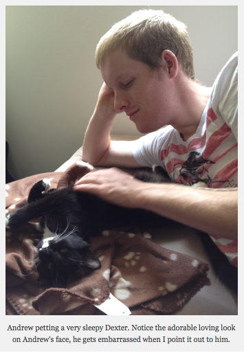 Andrew petting a very sleepy Dexter.