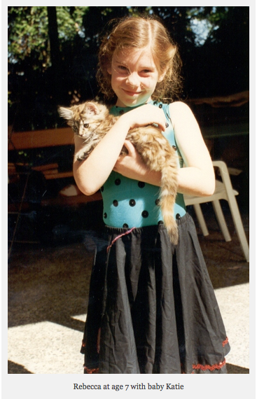 Rebecca as a little girl with Katie her kitten