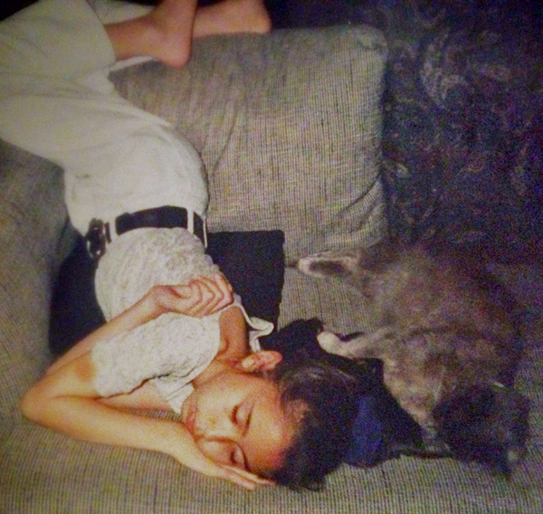 Me as 6th grader sleeping in a rather awkward position with Smokey right along beside me.