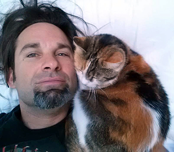 Best Selling author with his cat Xanadu