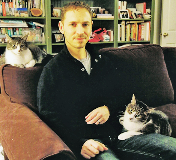 David Grimm with his cats
