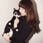 Photgrapher BriAnne Wills with her cat Tucker