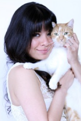 Author and illustrator Yasmine Surovec with cat