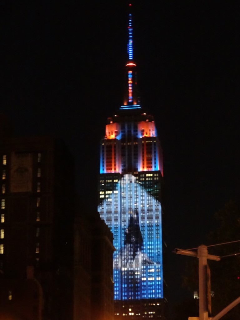 Whale projected against Empire State Buildilng