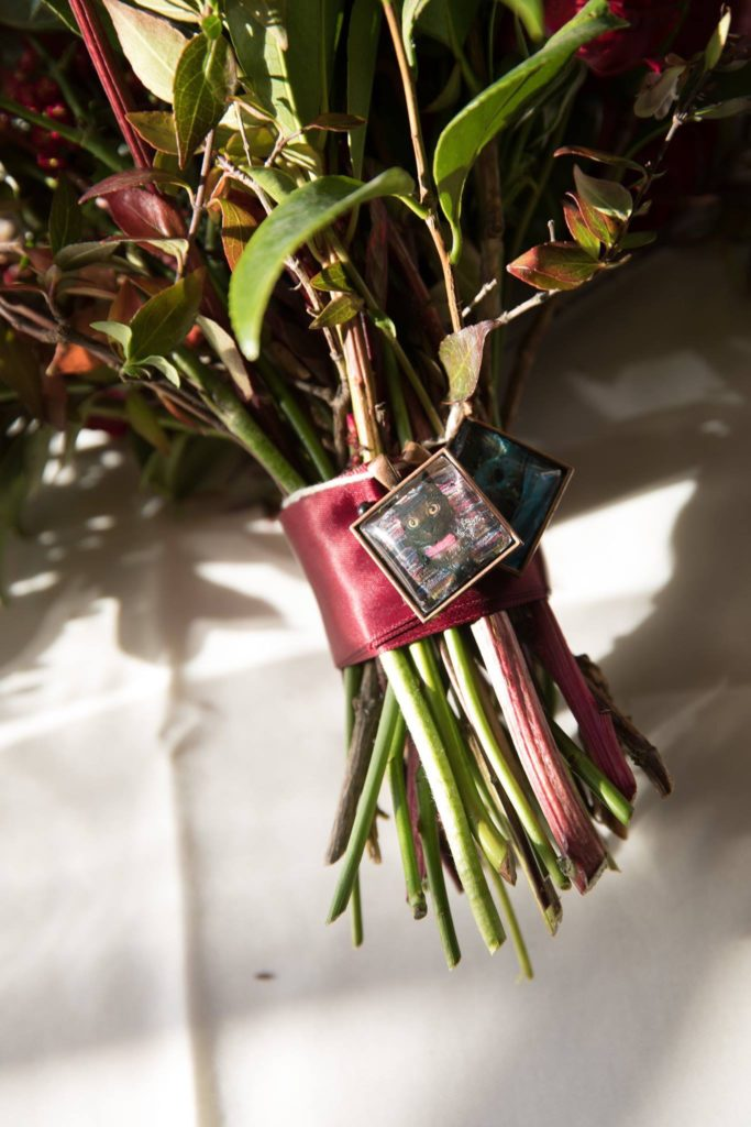 Danielle found a way to incorporate her current cats - current and past - into her ceremony by way of charms on her bouquet.